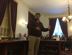 Faisal Gill speaking to the Vermont Democratic Party state committee - JOHN WALTERS