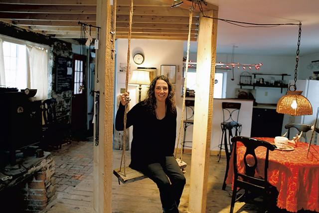 Stacy Hopkins in her jewelry studio, formerly a blacksmith shop - SARAH PRIESTAP