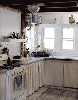 Hopkins and Meyerrose's remodeled kitchen features concrete countertops and a colander light fixture - SARAH PRIESTAP