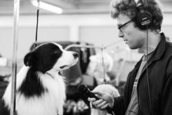 Chris Hoff interviewing a dog - ALYSSA KAPNIK SAMUEL
