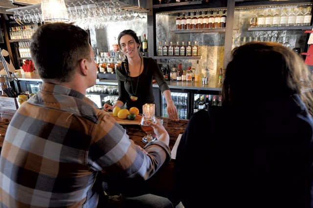 Emily Hassard visiting with bar customers - JEB WALLACE-BRODEUR