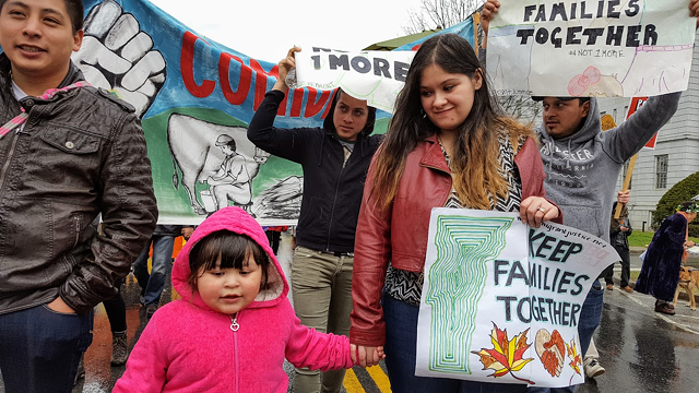 Cesar Alex Carrillo, left, with his young daughter, Solmarie, and wife, Lymarie Deida, leading a 2016 march to urge the release of an immigrant worker - COURTESY: MIGRANT JUSTICE