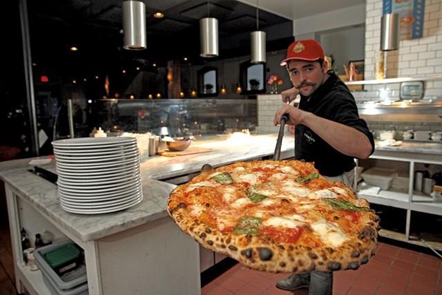 Griffeon Chuba with a hot pie at Pizzeria Verità - FILE: MATTHEW THORSEN
