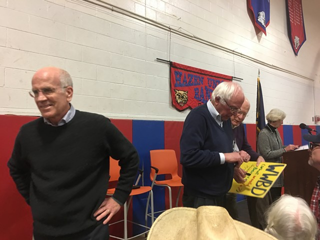 """Welch, Sanders and Leahy autograph a """"What Would Bernie Do?"""" sign. - JOHN WALTERS"""