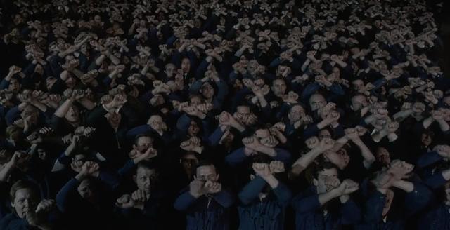 Oceanians watching propaganda - 1984 FILM STILL