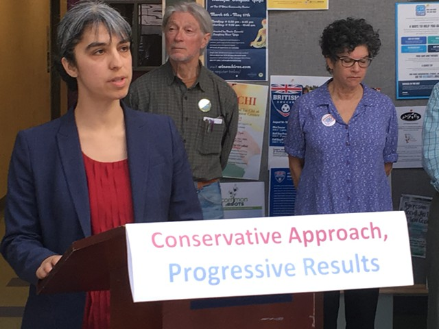 Rep. Diana Gonzalez (P/D-Winooski) talks up a carbon tax proposal Monday in Winooski with members of 350.org. - TERRI HALLENBECK
