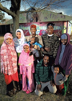 Aden Haji (back row, red cap) with his family - MATTHEW THORSEN