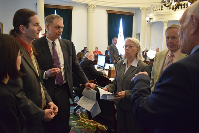 Sen. Dick Sears (right to left) confers with Sens. Bobby Starr and Peg Flory, Senate Secretary John Bloomer, Lt. Gov. David Zuckerman and Sen. Becca Balint on the Senate floor Friday. - TERRI HALLENBECK