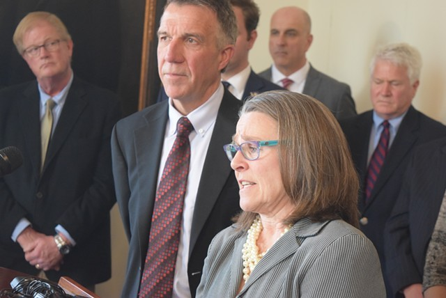 Gov. Phil Scott and his legal counsel, Jaye Pershing Johnson, at a press conference - FILE: TERRI HALLENBECK