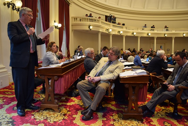 Rep. Tom Stevens (D-Waterbury) speaks for a paid family leave bill Tuesday on the House floor. - TERRI HALLENBECK