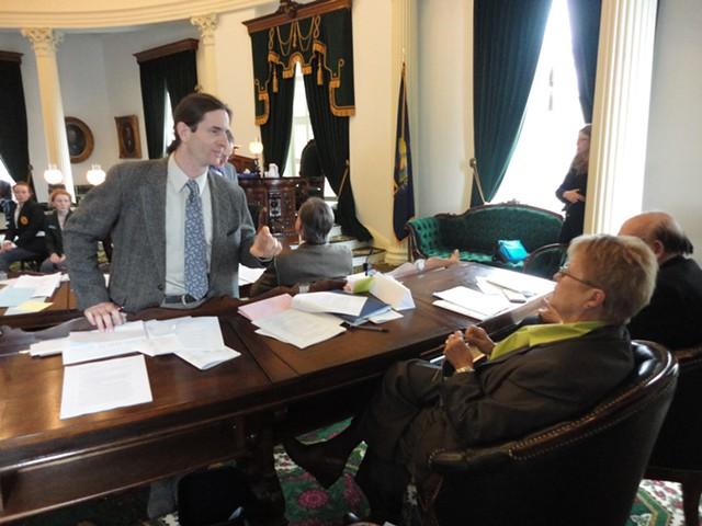 Lt. Gov. David Zuckerman in the Senate chamber, speaking with Sen. Ann Cummings (D-Washington)