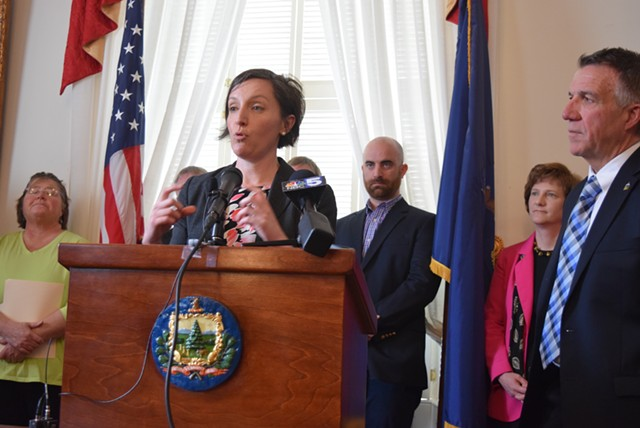 Nicole Mace, executive director of the Vermont School Boards Association, talks about potential savings in teacher health care costs, with Gov. Phil Scott last month. - TERRI HALLENBECK