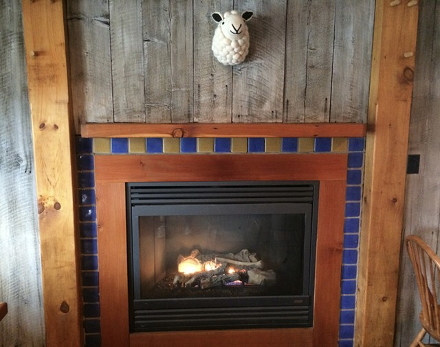 The fireplace at Shepherds Pub in Waitsfield - SUZANNE PODHAIZER