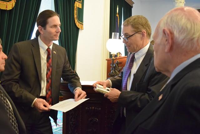 Lt. Gov. David Zuckerman (left) confers Friday afternoon with Senate Secretary John Bloomer (center) and Sen. Dick Sears. - TERRI HALLENBECK