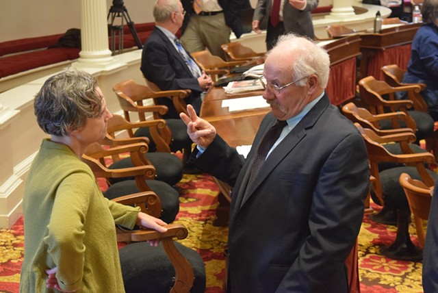 Rep. Bob Helm talks with Vermont State Colleges lobbyist Tricia Coates. - TERRI HALLENBECK