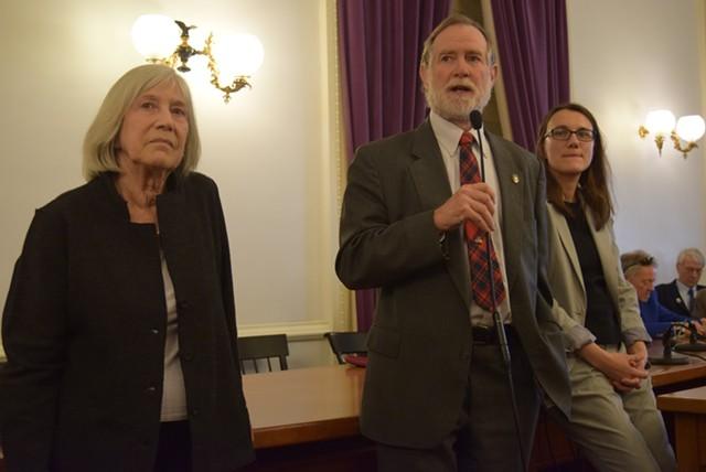 Rep. Dave Sharpe addresses the Democratic caucus Thursday as Rep. Janet Ancel, left, and Rep. Jill Krowinski look on. - TERRI HALLENBECK