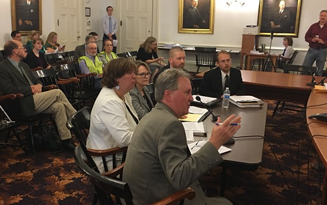Public Service Board officials testify before LCAR. Clockwise from front: Staff attorney John Cotter, Board members Sarah Hofmann and Margaret Cheney, utilities analyst Tom Knauer, and policy analyst Kevin Fink. - JOHN WALTERS
