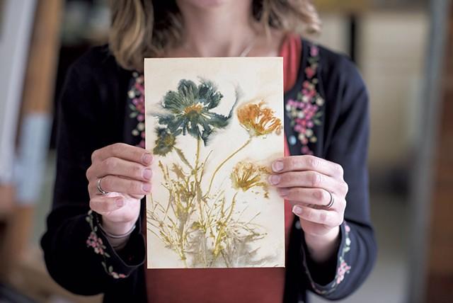 Kathryn Wyatt holding a flower print created at Studio Roji - CALEB KENNA