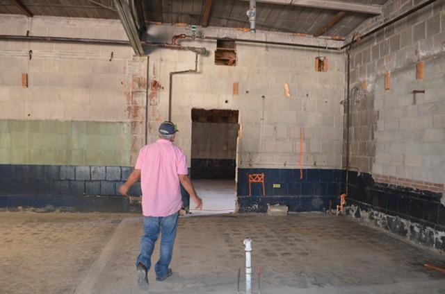John Koerner shows off the inside of the building. - SASHA GOLDSTEIN