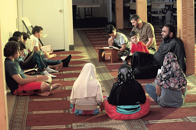 Imam Islam Hassan (far right) with his students - MATTHEW THORSEN