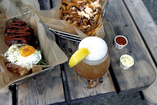 Parmesan truffle fries, Worthy Burger with egg and blue cheese, and the John Daly cocktail - SARAH PRIESTAP