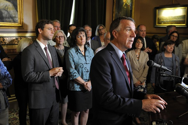 Gov. Phil Scott announces an agreement at the Statehouse Wednesday. - JEB WALLACE-BRODEUR