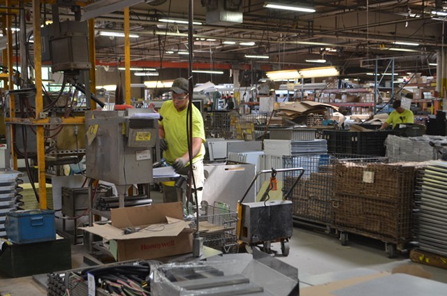 A Blodgett employee works in the assembly line - KATIE JICKLING