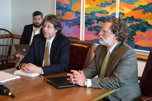 Economists Jeff Carr (left) and Tom Kavet address the state's Emergency Board on Friday. - TERRI HALLENBECK