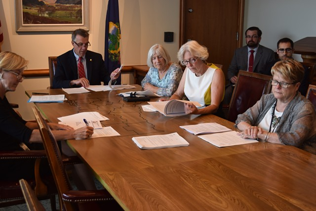 Gov. Phil Scott and legislators who make up the Emergency Board meet Friday in Montpelier to discuss state revenues. - TERRI HALLENBECK