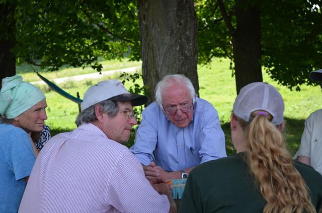 Sen. Bernie Sanders talks with dairy farmers in East Fairfield. - ALICIA FREESE