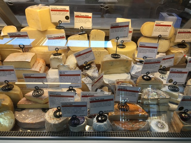 Cheese case at Mad River Taste Place - SALLY POLLAK