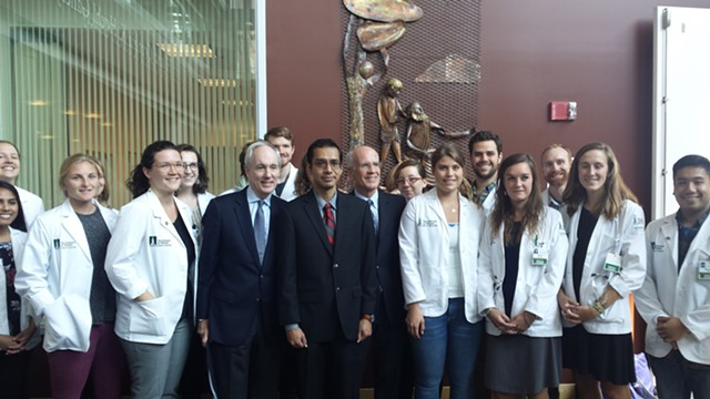Juan Conde (in red tie), flanked by UVM president Tom Sullivan (left), Congressman Peter Welch (right) and fellow medical students - KYMELYA SARI