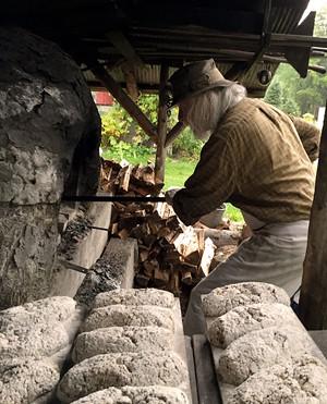 Peter Schumann baking rye bread - SALLY POLLAK
