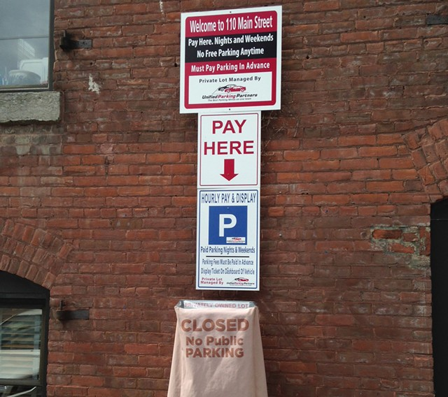 Parking sign at 110 Main Street - KEN PICARD