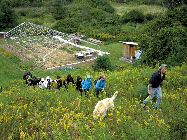 Jon Turner leading a group of students on a tour of the farm - MATTHEW THORSEN