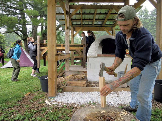 Working on the wood-fired pizza oven - MATTHEW THORSEN