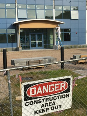 Construction fencing around the nearly complete building - MATTHEW ROY