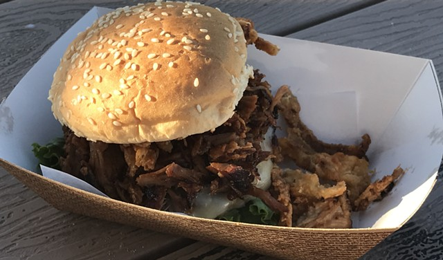 Burger topped with BBQ pork - SUZANNE PODHAIZER