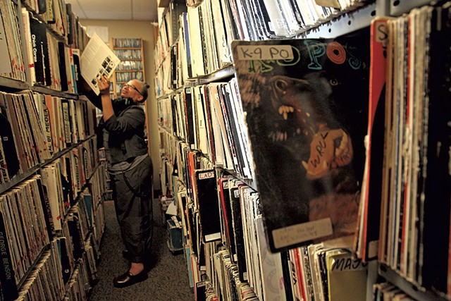 Melo Grant in the record stacks at WRUV - MATTHEW THORSEN