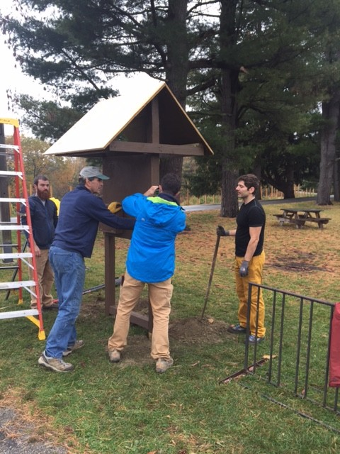Members of CRAG-VT help install a new sign-in kiosk at Rock Point. - COURTESY CRAG-VT