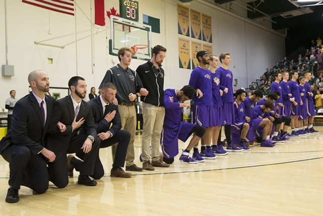Multiple St. Michael's players kneeled at Saturday's game, as did coach Josh Meyer (far left). - JAMES BUCK