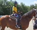 King Street Center Kids Learn to Ride Horses