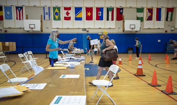 In-Person Voting Is Light, But Turnout High for Pandemic Primary