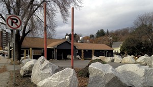 What's Up With the Boulders Surrounding a Defunct Barre Business?