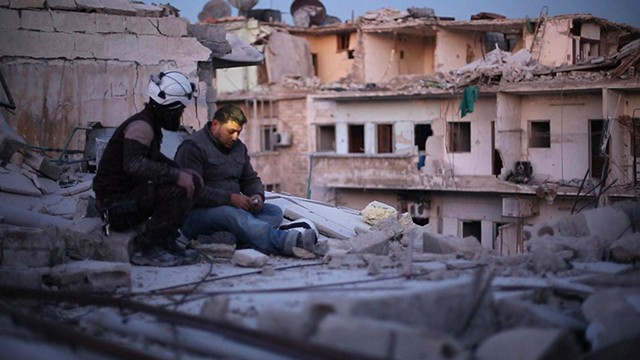 WRECKAGE OF WAR White Helmet Khaled pauses amid the rubble in Fayyad's wrenching documentary.