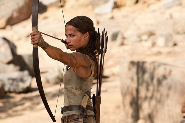 MISSING THE MARK Vikander does her best Katniss in this reboot of the video-game-based series, but it never catches fire.