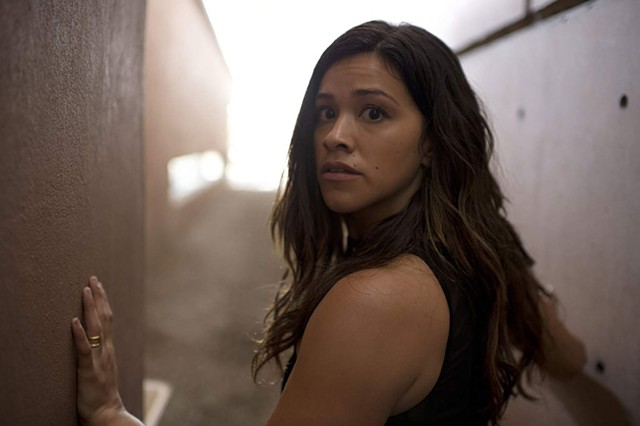 BOXED IN Rodriguez plays a woman who must fight for her survival after witnessing gang activity in Hardwicke's remake.