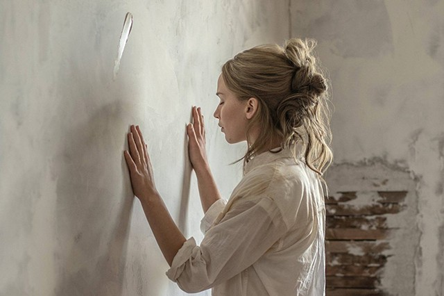 HOME ON THE DERANGED Lawrence communes with a wall in Aronofsky's deeply weird allegorical thriller.