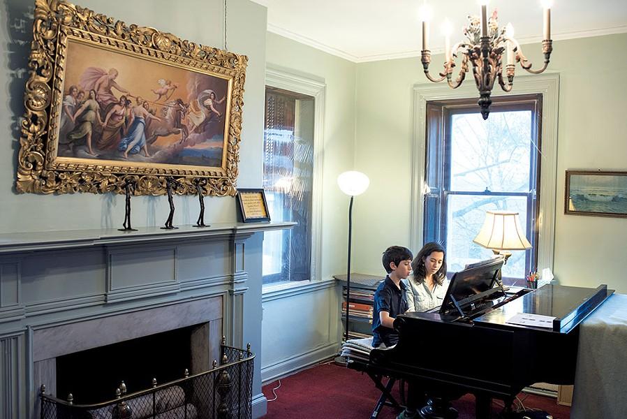 Sadie Brightman teaching piano to Jacob Graham - CALEB KENNA