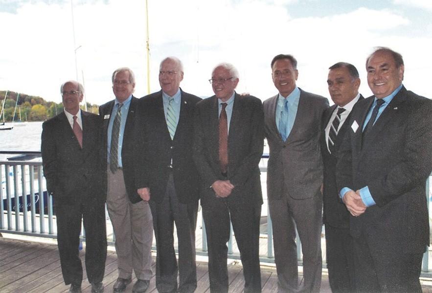 Left to right: Congressman Peter Welch, Bill Stenger, Sen. Patrick Leahy, Sen. Bernie Sanders, Gov. Peter Shumlin, Ariel Quiros and William Kelly in Newport in September 2012 - COURTESY: BILL STENGER